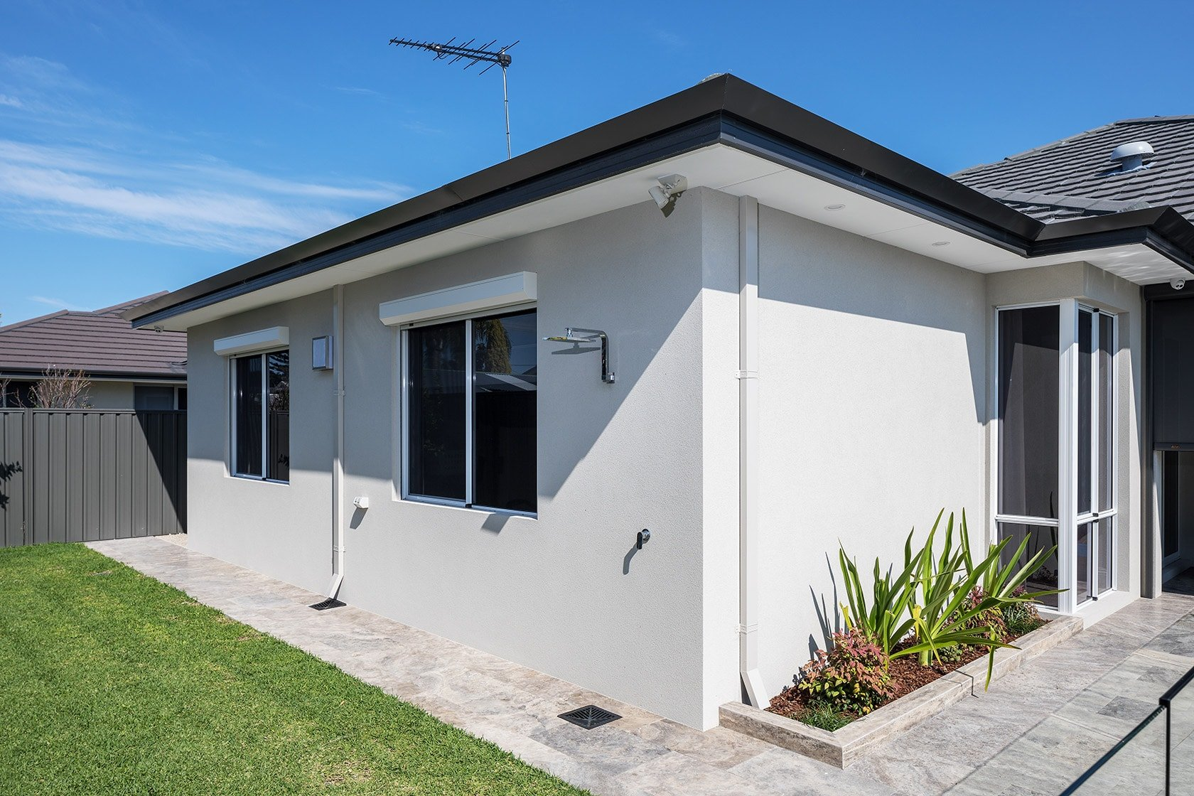 open white surfmist roller shutters on texture coated wall reveal fit dianella