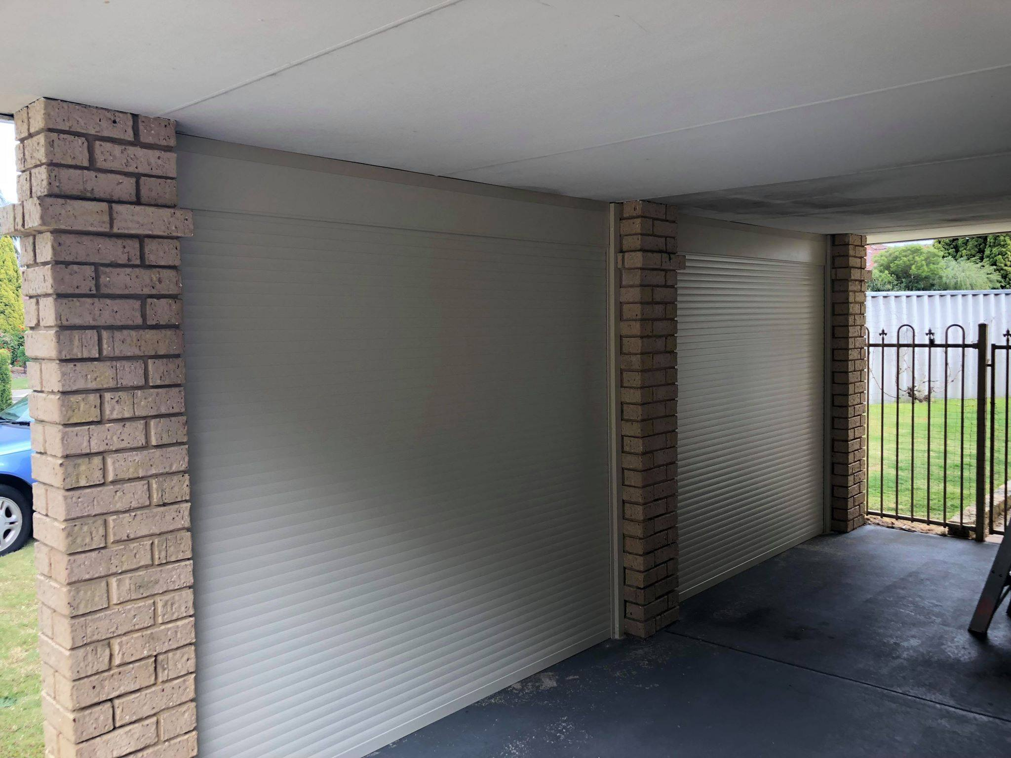 Roller Shutters on the side of a garage